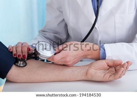 Close-up of measuring blood pressure, horizontal view
