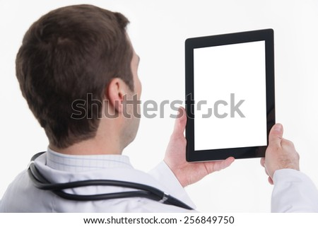 Close up of medical doctor hands holding tablet pc with empty screen - stock photo