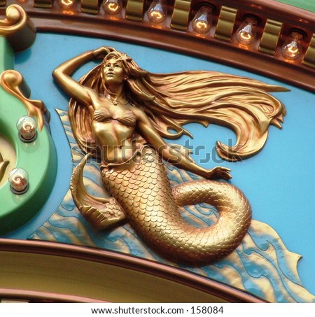 Close up of Mermaid figure on carousel - stock photo