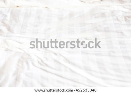 close up of messy bedding sheets - stock photo