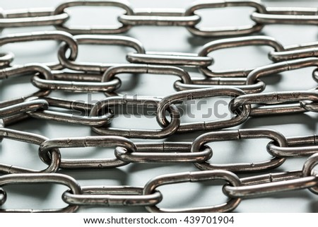 close up of metal chain part on white background - stock photo