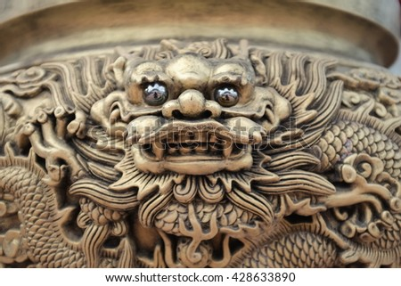 Close up of metal Chinese dragon  - stock photo