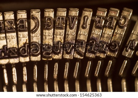 Close up of metal letters on vintage typewriter