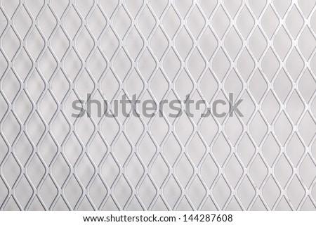 Close up of metal net - stock photo