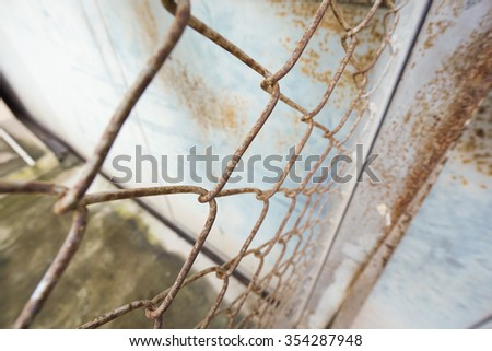 Close up of metal twist fence in prison - stock photo