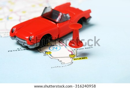 Close up of  Miami  USA map with red pin  and car - Travel concept - stock photo