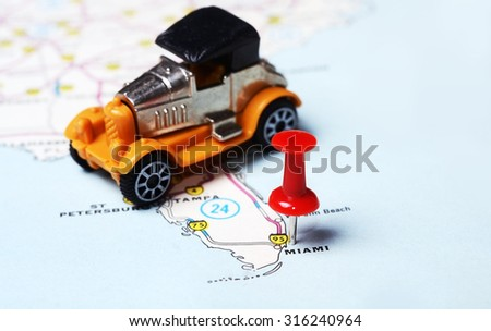Close up of  Miami  USA map with red pin and retro car toy  - Travel concept - stock photo
