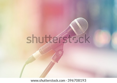 Close up of microphone, fill color filter pastel gradient tone.