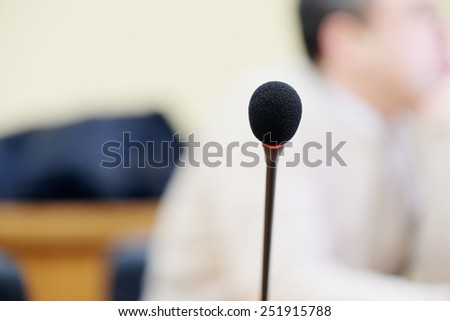Close up of microphone in auditorium - stock photo