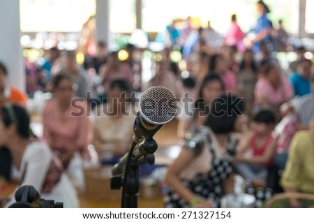 Close up of microphone in buddha pavilion or church on buddhist blurred background