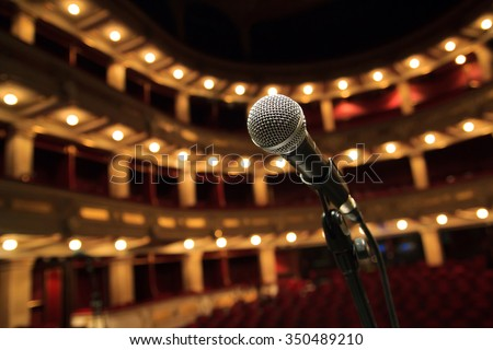 Close up of microphone in concert hall - stock photo