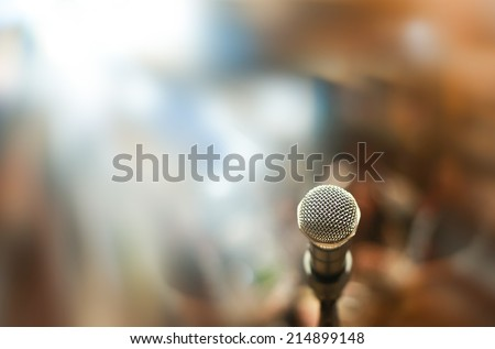 Close up of microphone in concert hall or conference room - stock photo