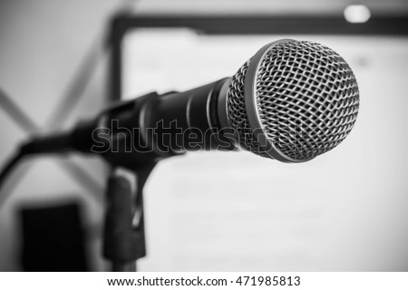 Close up of microphone in concert hall or conference room