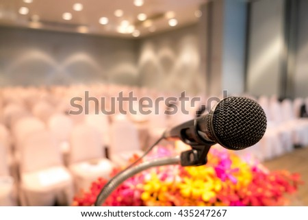Close up of microphone in concert hall or seminar room