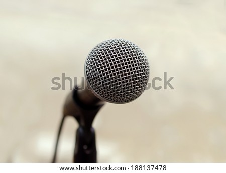 Close up of microphone in conference hall. - stock photo