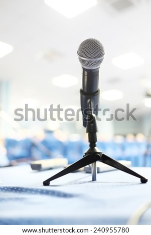 Close up of microphone in conference room - stock photo