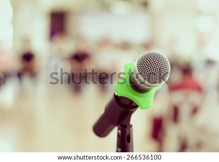 Close up of microphone in conference room on blurred background, vintage tone - stock photo