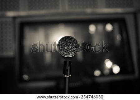 Close up of microphone in sound recording studio. - stock photo
