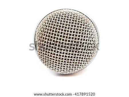 Close up of microphone on a white background, metallic microphone mesh has rusty. - stock photo