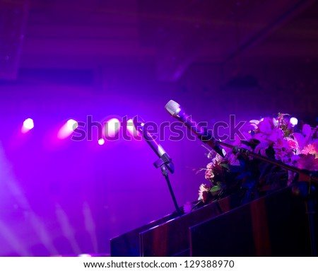 Close up of microphone on stage. - stock photo