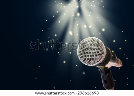 Close up of microphone on stage - stock photo