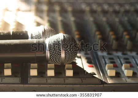 Close up of microphones put on sound music mixer control panel.