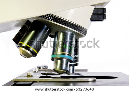 Close-up of microscope isolated over white  background medical and cancer research concept