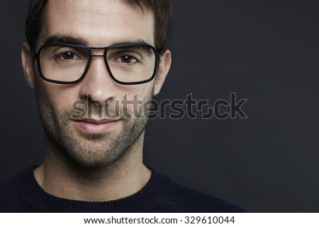 Close up of mid adult man in spectacles