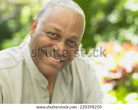 Close up of middle-aged African man smiling - stock photo