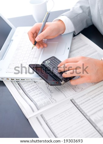 Close up of middle aged business man is working at the desk