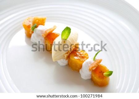 Close up of minimalist caramelized banana dessert. - stock photo