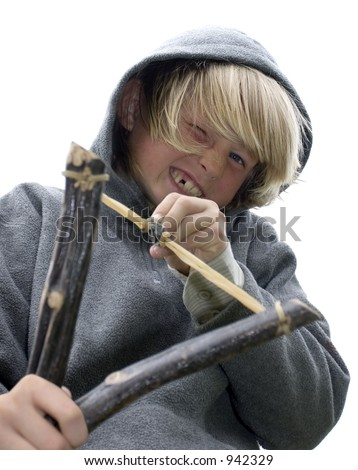close-up of mischievous boy with slingshot