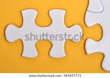 Close Up of Missing Puzzle on Yellow Background, Searching a Solution and Business Concept