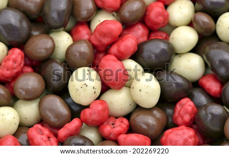 Close-up of mixed chocolate-covered coffee beans to use as background - stock photo