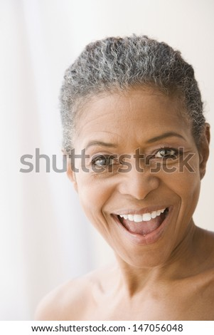 Close up of mixed race woman looking surprised