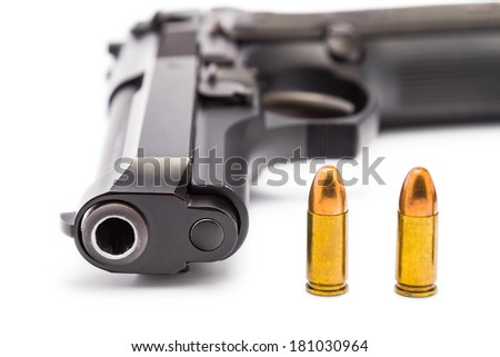 Close up of 9 mm. handgun focusing on the bullets and the muzzle of gun - stock photo