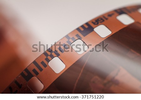 Close-up of 35 mm photographic film at the blurred background - stock photo
