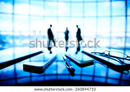 Close-up of mobile phones on office table - stock photo