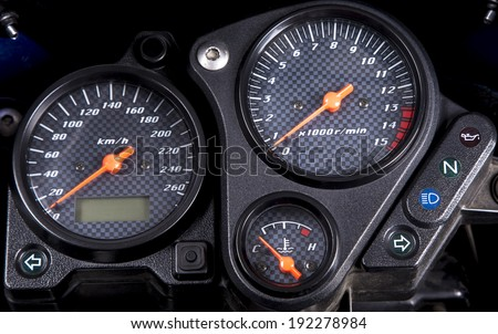 Close up of modern and stylish motorcycle dashboard. - stock photo