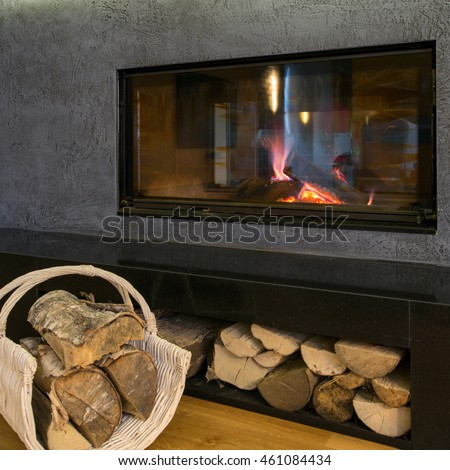 Close-up of modern burning fireplace in living room