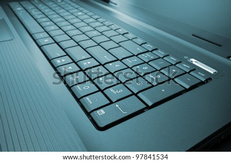 Close-up of modern laptop keyboard. Toned - stock photo