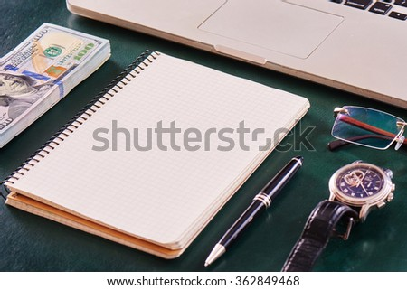 close up of modern working table top view businessman or designer or architect or manager or student or teacher or doctor or lecturer with notebook on leather table with copy space mock up. - stock photo