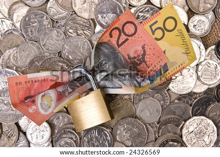 close up of money with padlock - australian currency, notes and coins