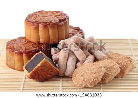 Close up of mooncakes and mid autumn pastry on bamboo mat. (The chinese words indicates the type of mooncake, not the brand)