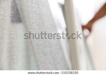 close up of mosquito net and window background - stock photo