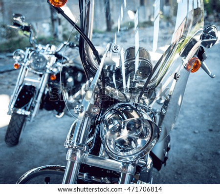 Close up of motorcycle headlight. Chrome