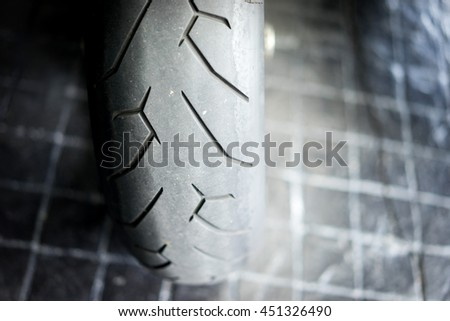 Close up of motorcycle tire. Close Up Detail - stock photo
