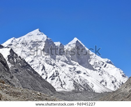 close up of mountain Bhagirathi peaks against deep blue sky in Indian Himalayas