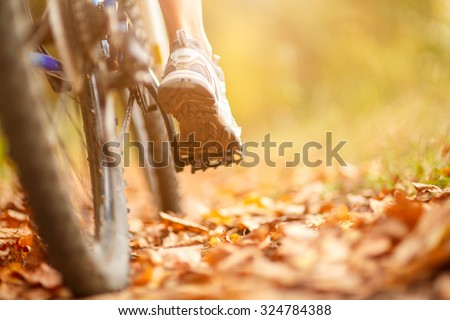 close-up of mountain bike in city park.  Sunflare at background - stock photo