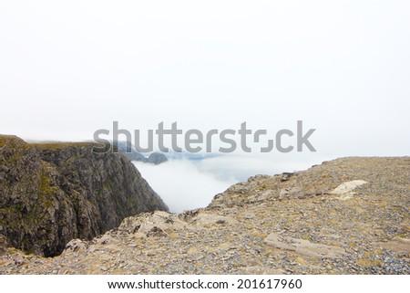 Close-up of mountain peak on mist background - stock photo